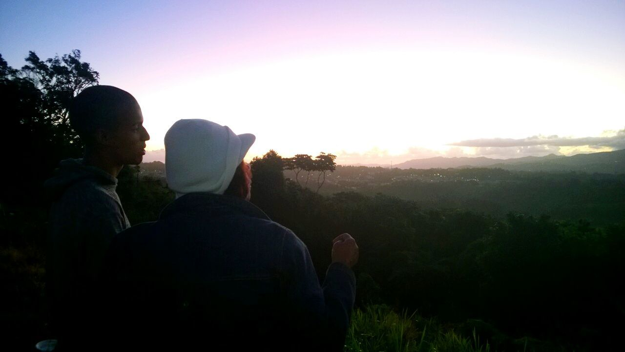Man And Woman Enjoying The View Of Mountains