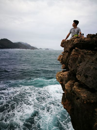 Ready for the beauty and unpredictability that is the future Be. Ready. Rock - Object Full Length Adventure Adult Cloud - Sky Landscape Outdoors Vacations RISK Sea Nature Indonesia_photography Beach INDONESIA Pantai Timang Perspectives On Nature Physical Geography Beauty In Nature