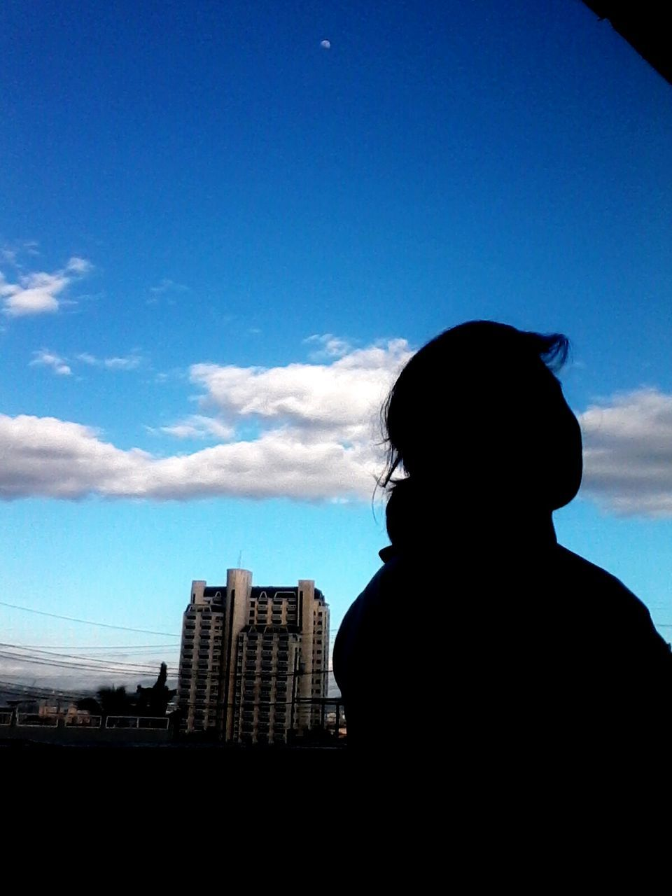 silhouette, sky, architecture, one person, skyscraper, building exterior, real people, city, cityscape, day, outdoors, people