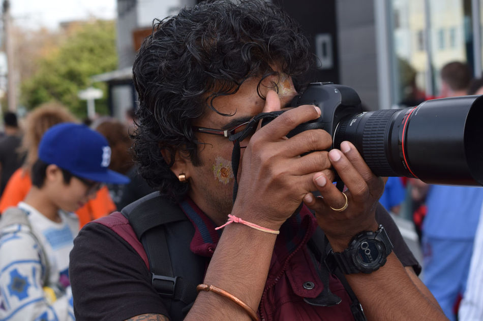 A photographer sets up to take a photo Camera, First Test Shots.. Casual Clothing Front View Head And Shoulders Hobbies Holding Lifestyles Occupation Person Photographer Real People