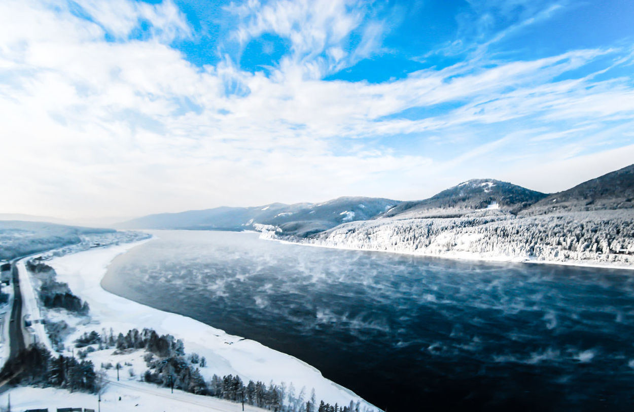 Siberian river Yenisei doesn't freeze during the winter Beauty In Nature Blue Cloud Colors Landscape Majestic Mountain Nature Non-urban Scene Physical Geography River Russia Siberia Sky Snow The Great Outdoors - 2016 EyeEm Awards Tranquil Scene Tranquility Travel Destinations Travel Photography Winter Yenisei River Yenisey