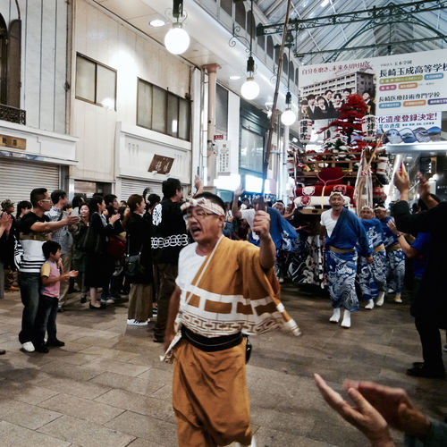 A Better Tomorrow : Enokizumachi, Hamanomachi Arcade. October 9 2015 AMPt - My Perspective Clapping Hands Japanese Festival End Of The Day Nagasaki Kunchi Festival On The Street Snapshot Of Life Street Photography 長崎くんち 最終日 October2015 Night Photography Real People Returning Home Panasonic Lumix GX1 LUMIX G VARIO 14-45/F3.5-5.6 28mm