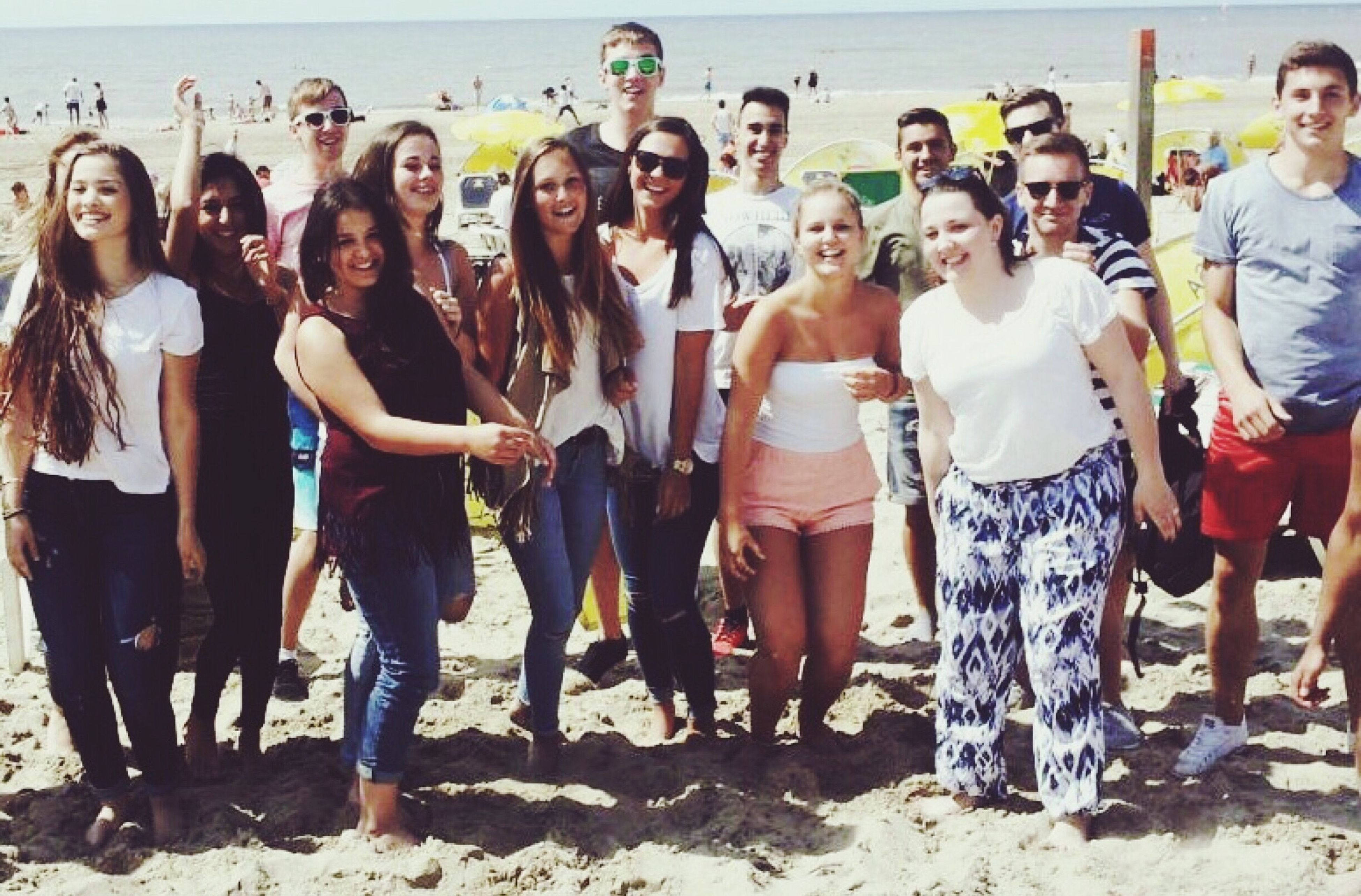 togetherness, lifestyles, large group of people, leisure activity, person, men, vacations, beach, friendship, bonding, water, enjoyment, standing, tourist, love, sea, casual clothing, tourism, mixed age range
