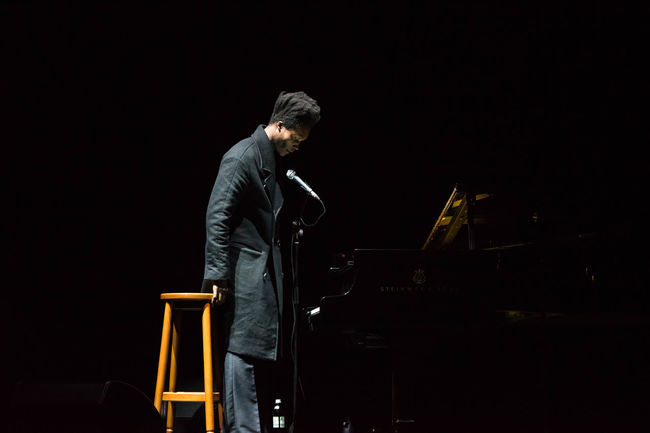 Performance of Benjamin Clementine in Kiev Ukraine Benjamin Clementine Casual Clothing Colors Dark Holding Illuminated Men Night Occupation Performance Performer  Performer  Person Playing Professional Occupation Skill  Sky Standing Three Quarter Length