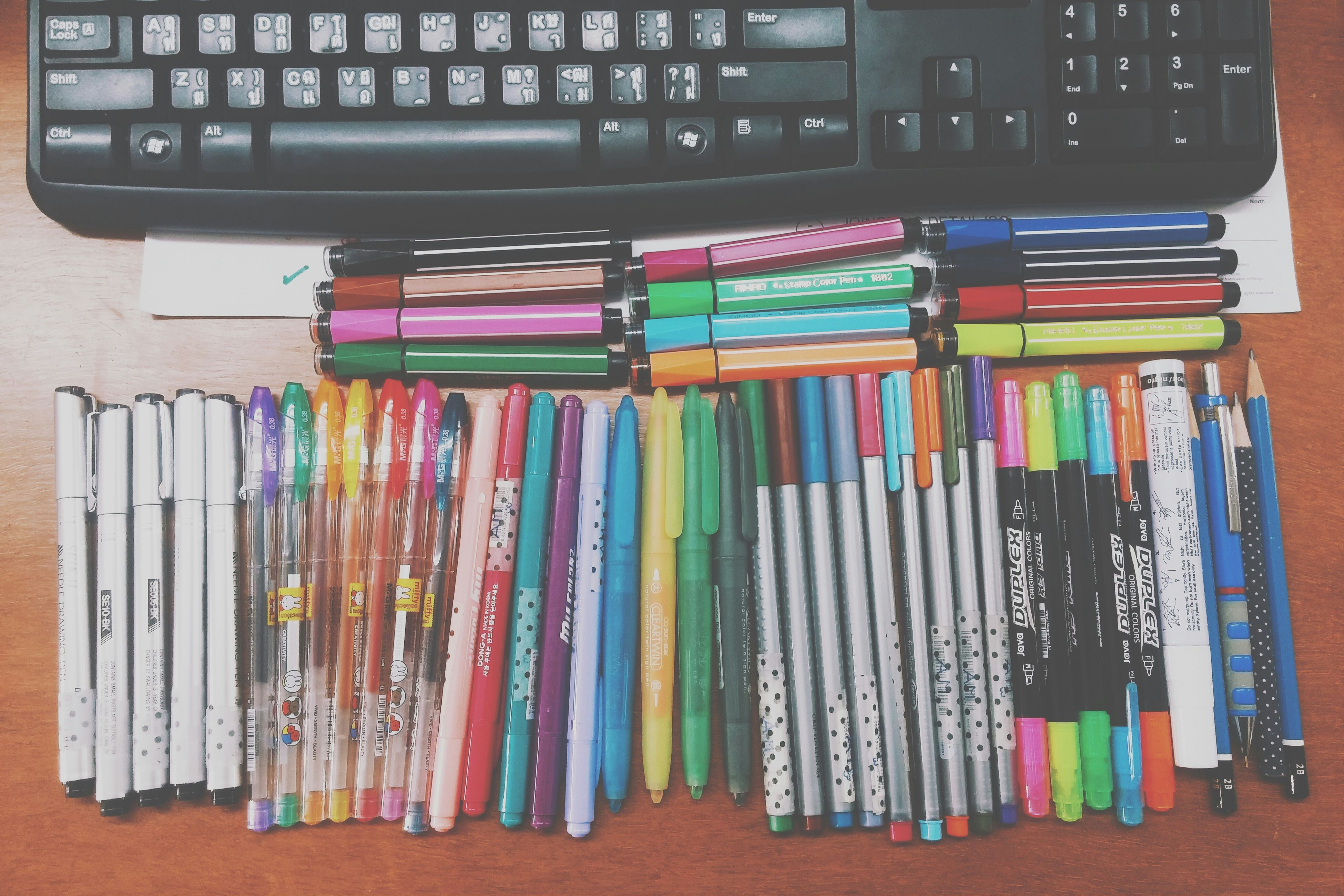 variation, large group of objects, indoors, multi colored, choice, arrangement, still life, education, order, in a row, abundance, collection, book, shelf, side by side, stack, literature, colorful, pencil, table