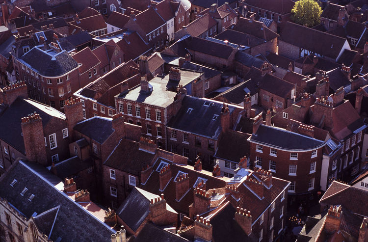 A from above view of chimnies and rooftops in england Aerial View Architecture Backgrounds Brick Chimney Pots City Cityscape Clay England Historic Old Outdoors Residential District Residential Structure Roof Roof Tile Roofscape Rooftops Slate Tiles Town Urban Windows