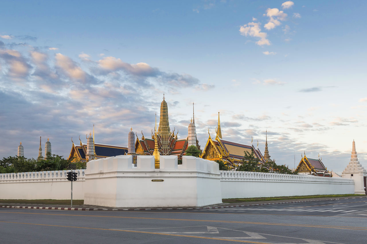 Empty road outside Wat Phra Kaew and Grand Palace at dawn Architecture Architecture Bangkok Blue Sky Buddhist Temple Cityscape Empty Road Grand Palace Bangkok Thailand Historical Building Morning Sky No People Rattanakosin Island Religion And Tradition Religious Place Royal Palace Sanamluang Southeast Asia Street Temple Architecture Temple Of Emerald Buddha Thailand Travel Travel Destinations Travel Photography Wat Phra Kaew First Eyeem Photo