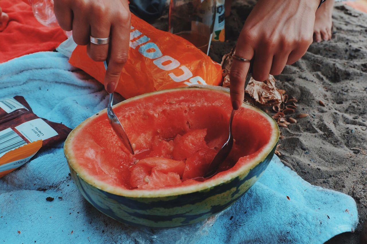 Food And Drink Real People Food Freshness One Person High Angle View Lifestyles Healthy Eating Human Hand Outdoors Day Human Body Part Close-up People Watermelon Summer