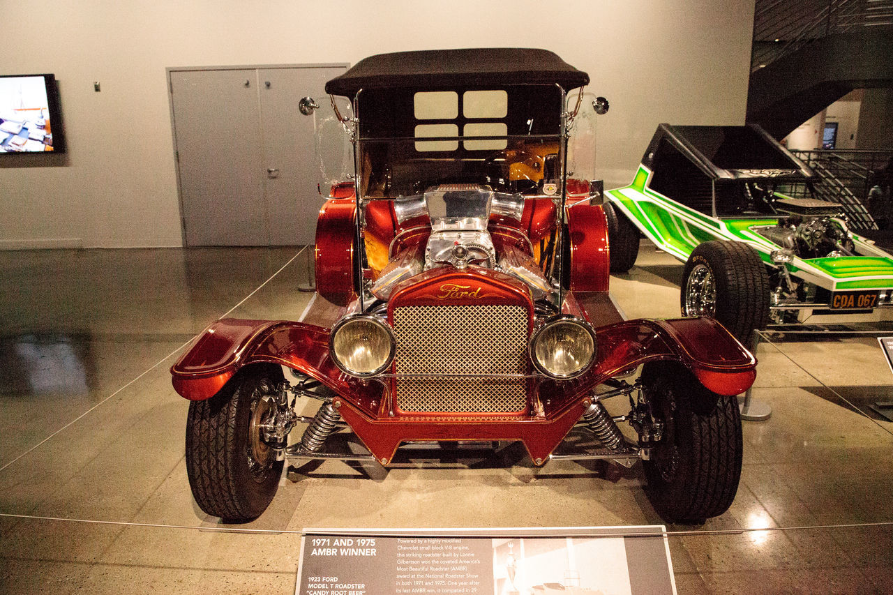 Los Angeles, CA, USA - July 23, 2017: Red candy colored 1923 Ford Model T Roadster called Candy Root Beer displayed at the Petersen Automotive Museum. Editorial use. 1923 Antique Car Candy Root Beer Classic Car Fast Car Ford HotRod Model T Petersen Automotive Museum Roadster Day Hot Rod Indoors  Land Vehicle Mode Of Transport Motorcycle No People Restored Car Transportation