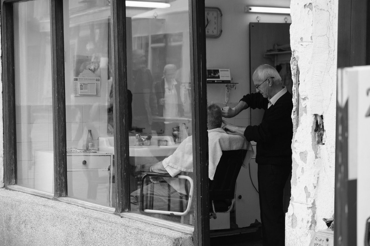 Adults Only Blackandwhite Hairdresser Hairdressing Looking Through Window Real People Reflection Snap A Stranger Three Quarter Length Window