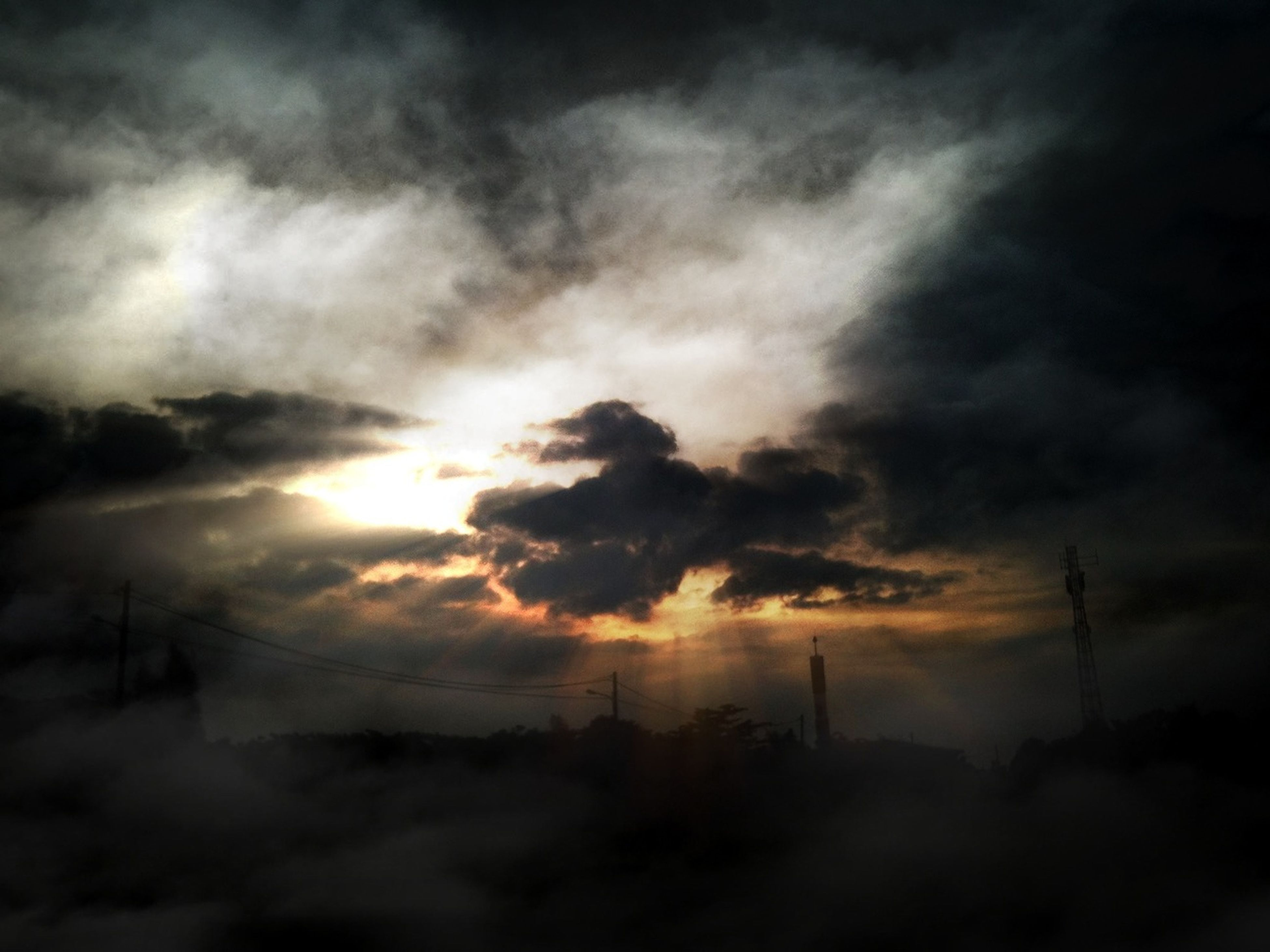 sky, cloud - sky, silhouette, sunset, fuel and power generation, cloudy, electricity pylon, tranquility, tranquil scene, beauty in nature, electricity, scenics, weather, nature, low angle view, power line, power supply, technology, cloud, dramatic sky