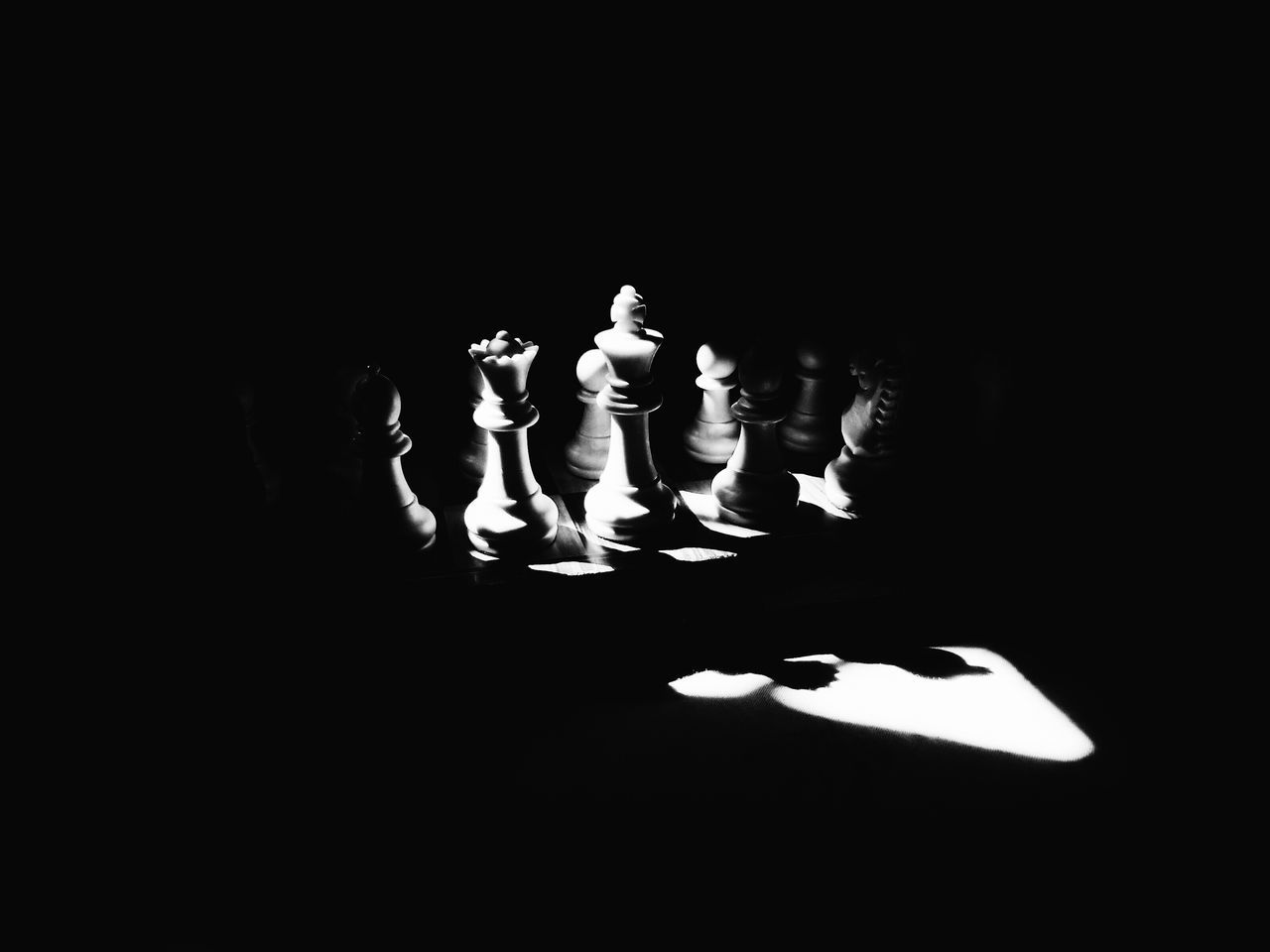Sunlight On Chess Pieces On Chessboard