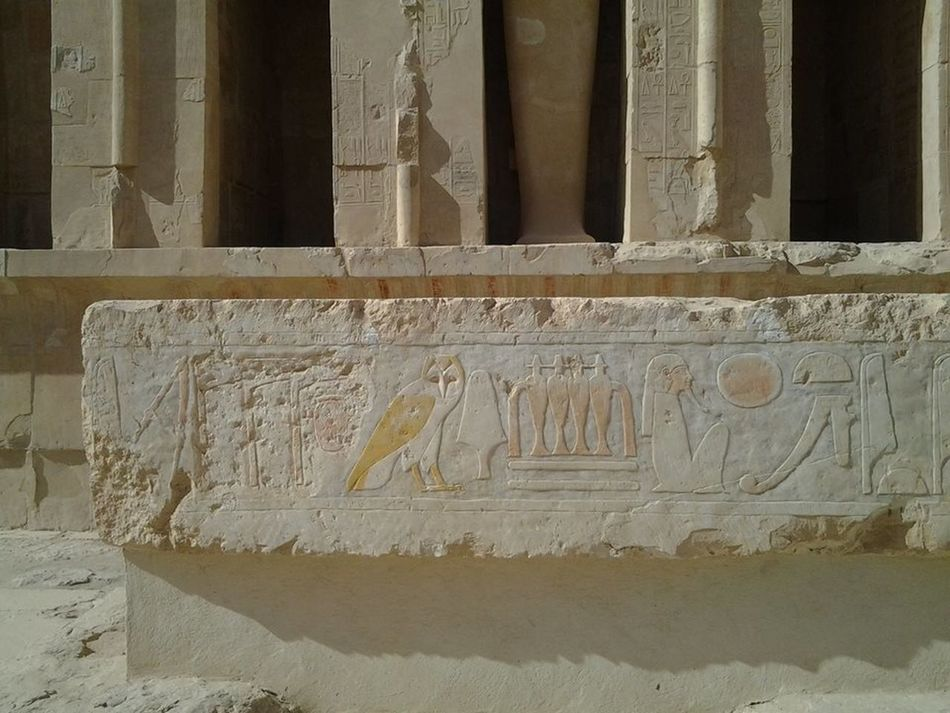 Ancient Civilization Architectural Column Architecture Art And Craft Bas Relief Building Exterior Built Structure Carving - Craft Product Close-up Creativity Day History Human Representation Luxer Egypt No People Outdoors Representing Sculpture Temple Of Hatshepsut Text
