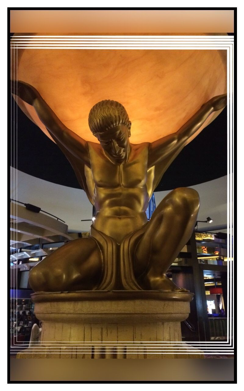 statue, sculpture, gold colored, indoors, illuminated, low angle view, architecture, no people, day