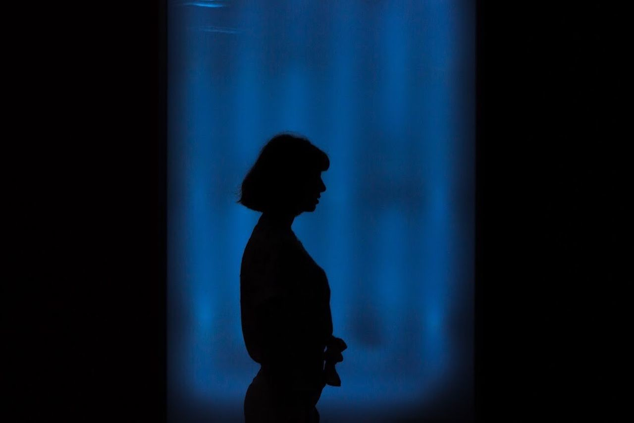 Adult Blue Childhood Children Only Curtain Day Indoors  One Boy Only One Person People Real People Silhouette Standing