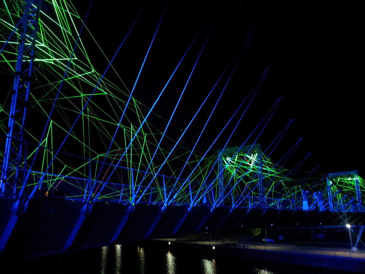 Light Kortrijk Bridge Bridge View Light And Dark Lightshow Light Effects Spiderweb Arts Culture And Entertainment Street Photography Night Photography Lines And Lights Lines Of Light Lines Everywhere Water Reflections Cities At Night The Architect - 2016 EyeEm Awards