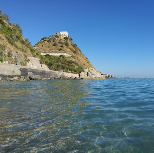 Sangregorio San Gregorio Capo D'Orlando Sea Beach Blue Landscape Rock - Object Water Outdoors Scenics No People Summer Tranquility Clear Sky Travel Destinations Nature Sand Day Mountain Beauty In Nature Sky Refraction Sicily Nebrodi