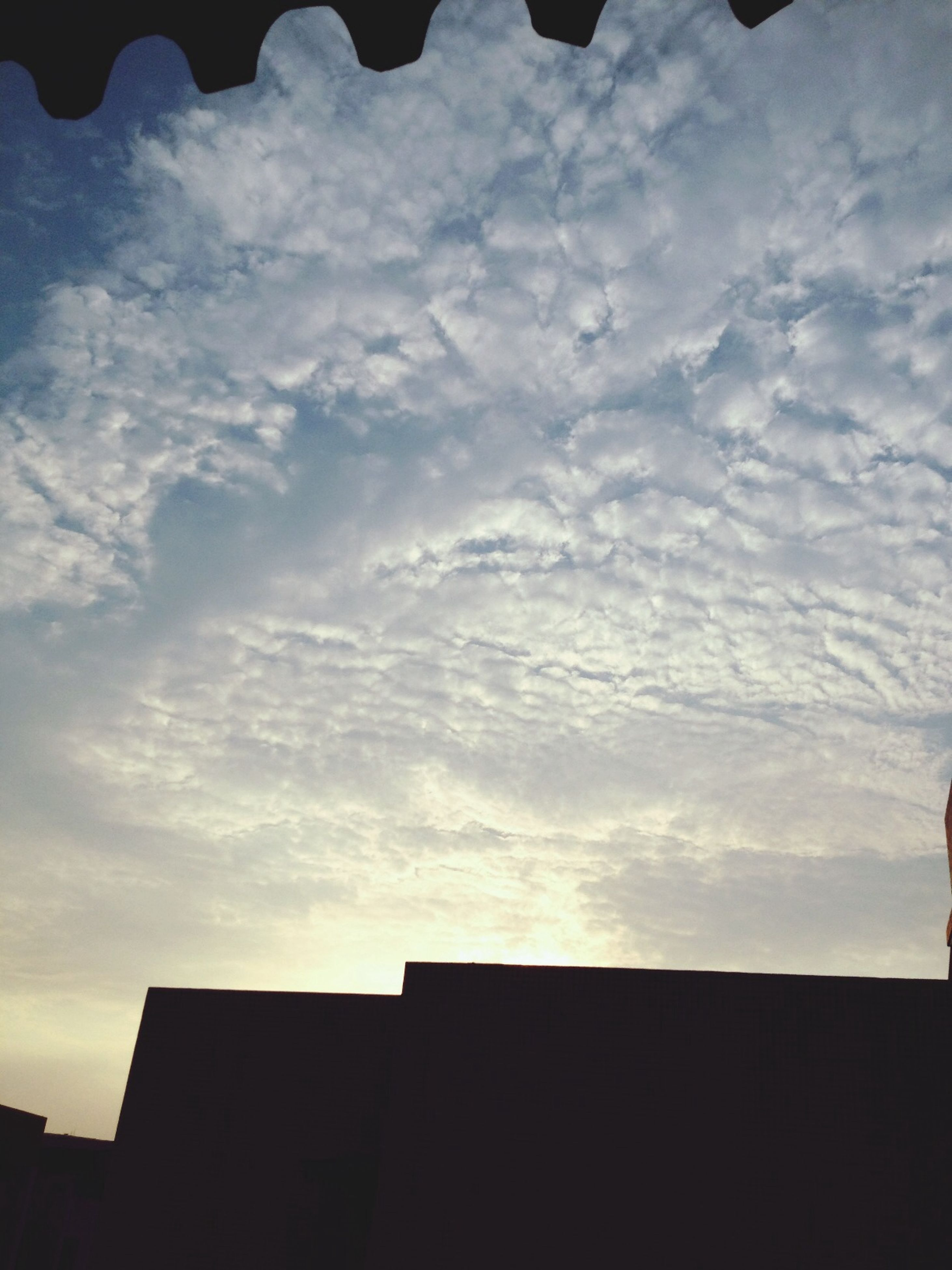sky, silhouette, architecture, built structure, low angle view, building exterior, cloud - sky, cloud, sunset, cloudy, house, high section, nature, beauty in nature, outdoors, building, no people, residential structure, dusk, scenics