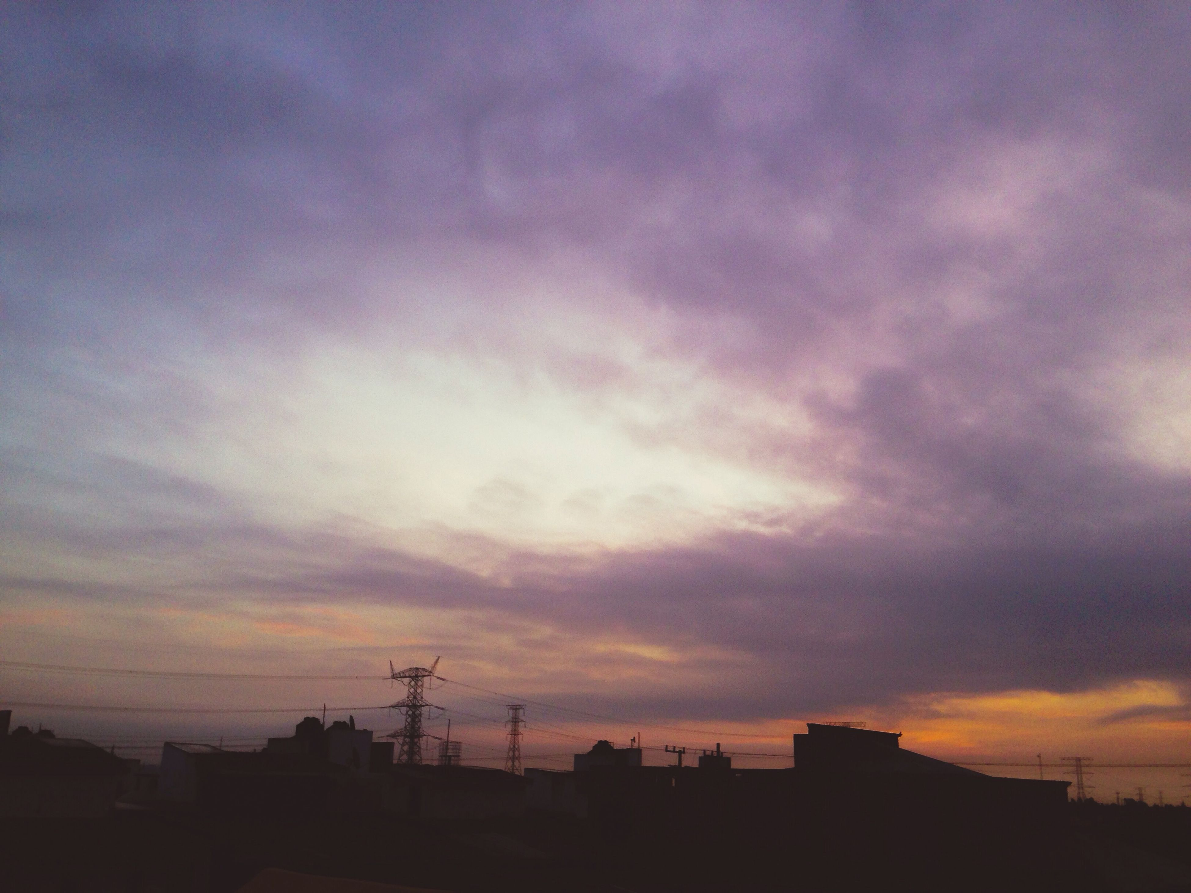 sunset, silhouette, sky, building exterior, architecture, built structure, cloud - sky, low angle view, cloudy, orange color, cloud, dramatic sky, beauty in nature, house, scenics, nature, dusk, residential structure, building, outdoors