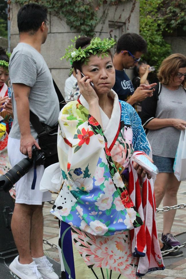 Woman waiting to perform at the traditional dance festival at Yoyogi Park, Tokyo, Japan. A wonderful clash between tradition and technology. Colors Culture Dance Front View Japan Lifestyles Modern Old Vs New Performance Person Photojournalism Portrait Streetphotography Technology Tokyo Traditional