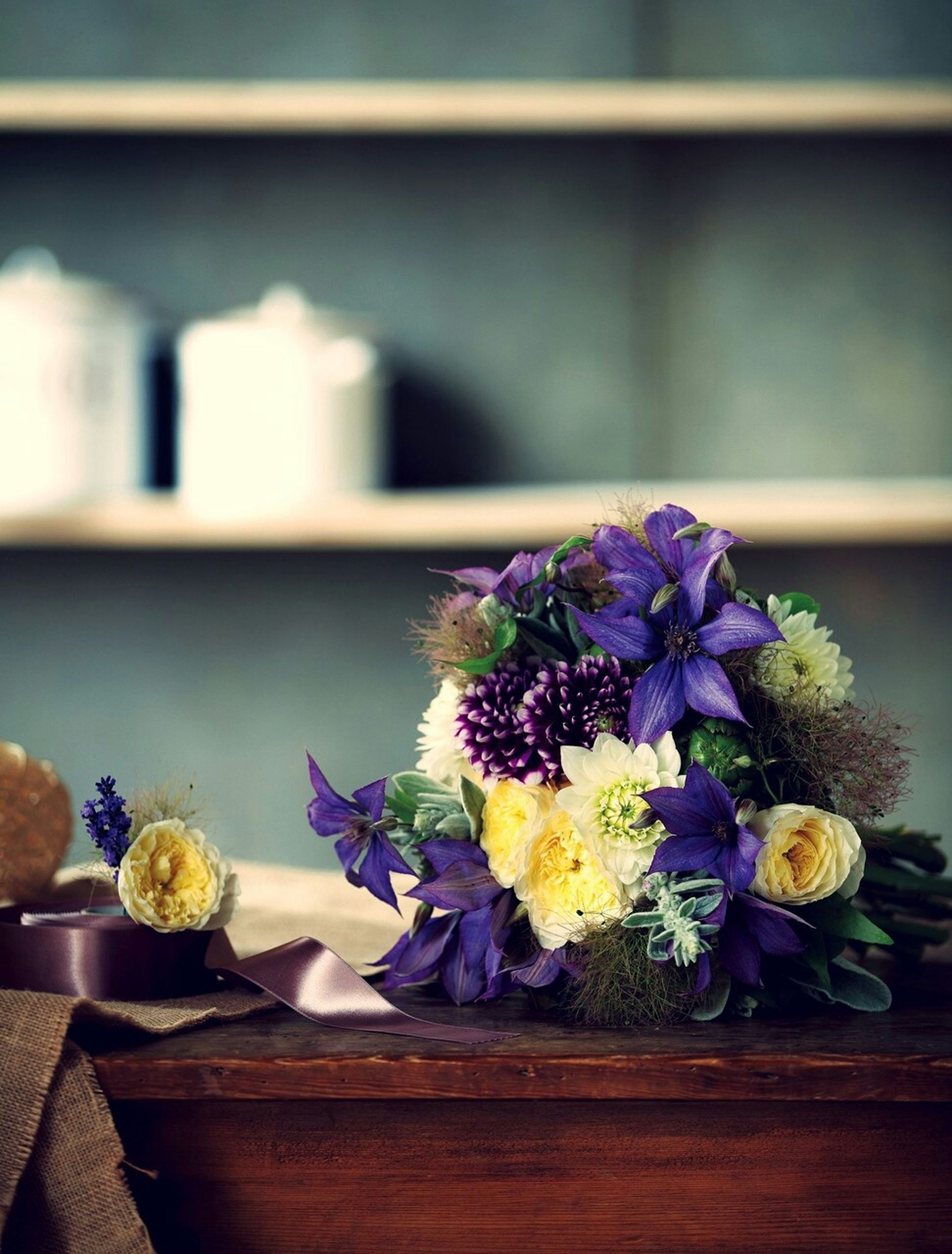flower, indoors, freshness, fragility, petal, vase, table, potted plant, flower head, focus on foreground, wood - material, plant, close-up, beauty in nature, flower pot, bouquet, flower arrangement, bunch of flowers, nature, home interior