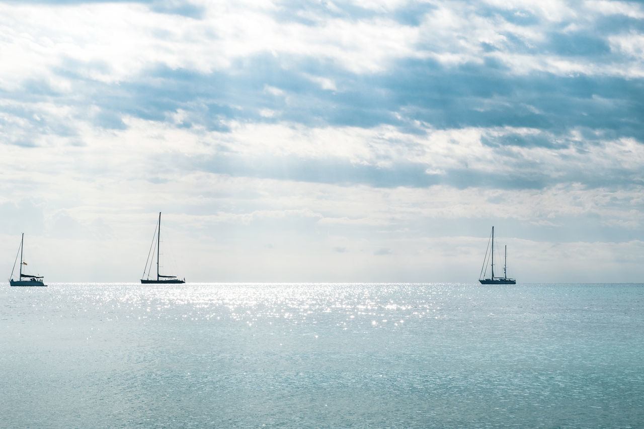 Beauty In Nature Cloud - Sky Day Floating On Water Glowing Horizon Over Water Majorca Nature Nautical Vessel No People Outdoors Sailboat Sailing Sailing Ship Scenics Sea Sky Summer Sunlight Tranquil Scene Transportation Vacations Water Yacht Yachting