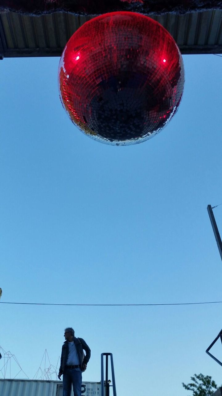 blue, low angle view, clear sky, red, hanging, day, outdoors, sky, people