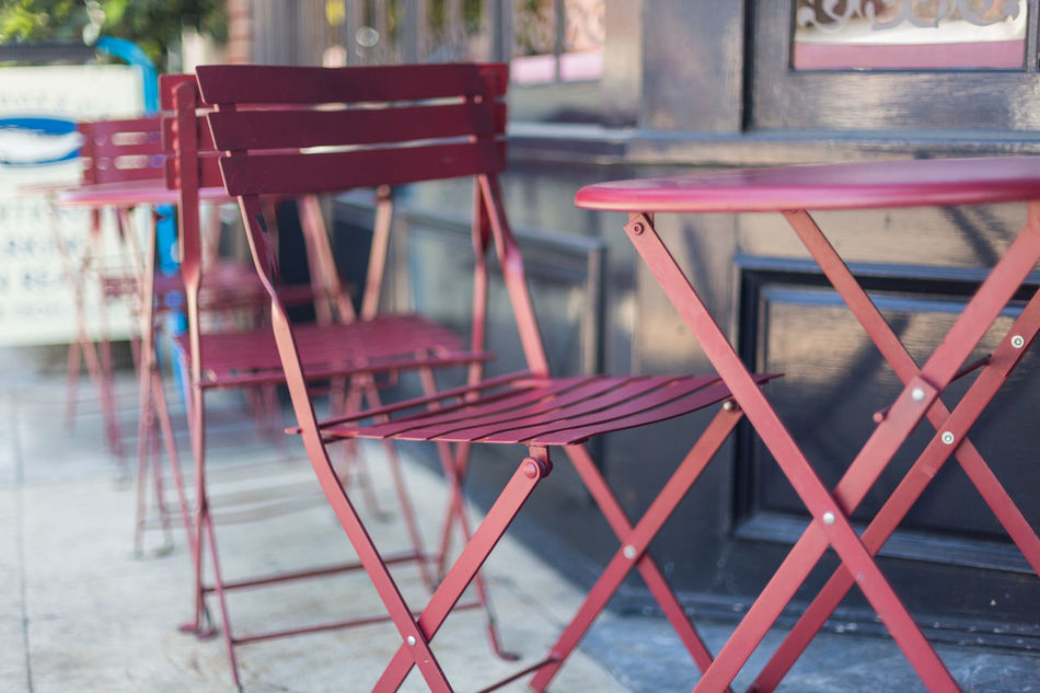 Red table and chairs Cafe Chairs Close-up Day Glow Metal Tables No People Patio Red Chairs Red Tables Refelction  Shaded Shallow Depth Of Field Tables Windows