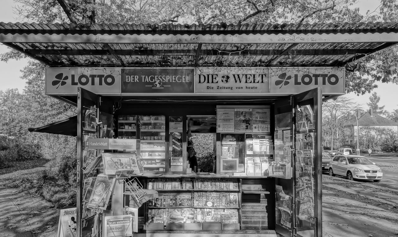B&w Black And White Information Information Sign Kiosk News Newspaper Newspaper Kiosk No People Outdoors Road Sign Street Photography Text Tree Western Script Zeitung Zeitungen
