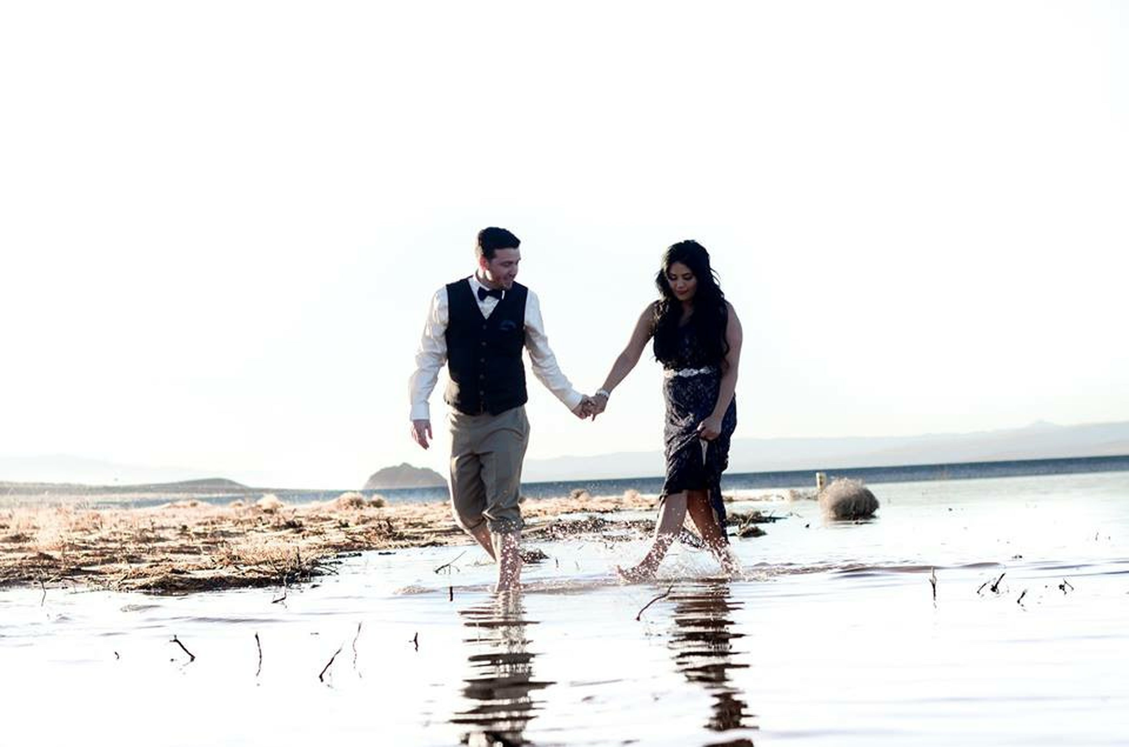 water, clear sky, copy space, leisure activity, lifestyles, full length, beach, togetherness, sea, standing, horizon over water, bonding, men, shore, boys, vacations, casual clothing, rear view