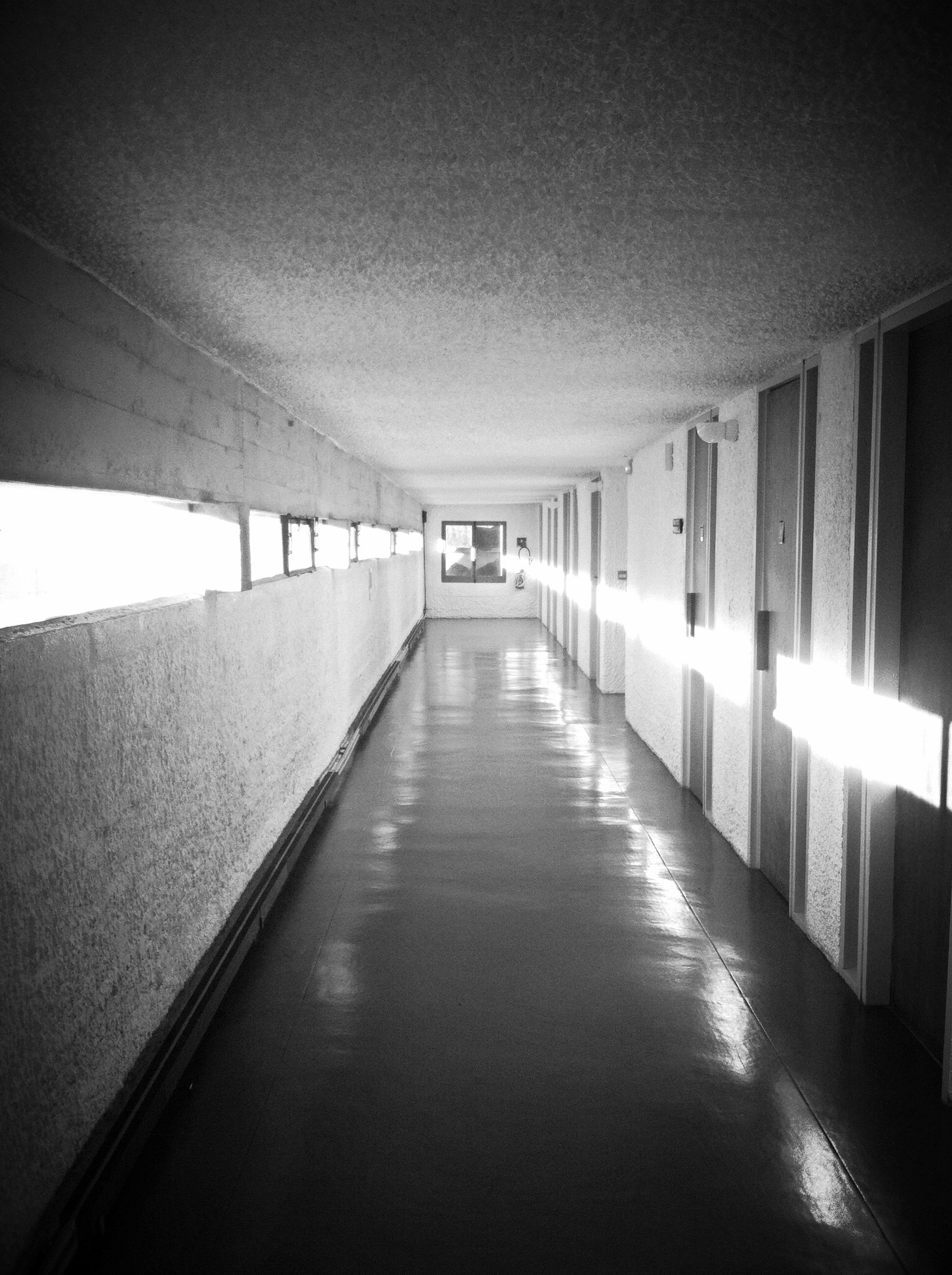 the way forward, architecture, built structure, indoors, diminishing perspective, corridor, ceiling, empty, vanishing point, narrow, long, absence, illuminated, building, in a row, flooring, walkway, wall - building feature, lighting equipment, no people