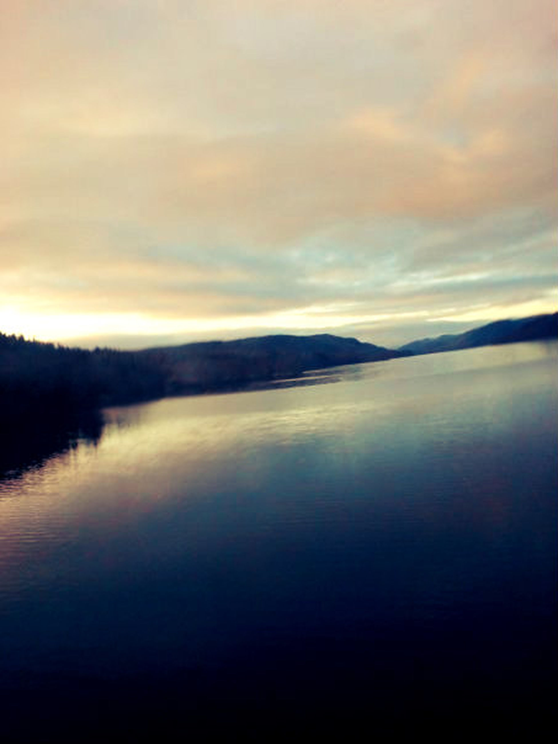 tranquil scene, tranquility, water, scenics, beauty in nature, sky, lake, reflection, sunset, cloud - sky, nature, mountain, waterfront, idyllic, cloud, calm, silhouette, cloudy, dusk, non-urban scene
