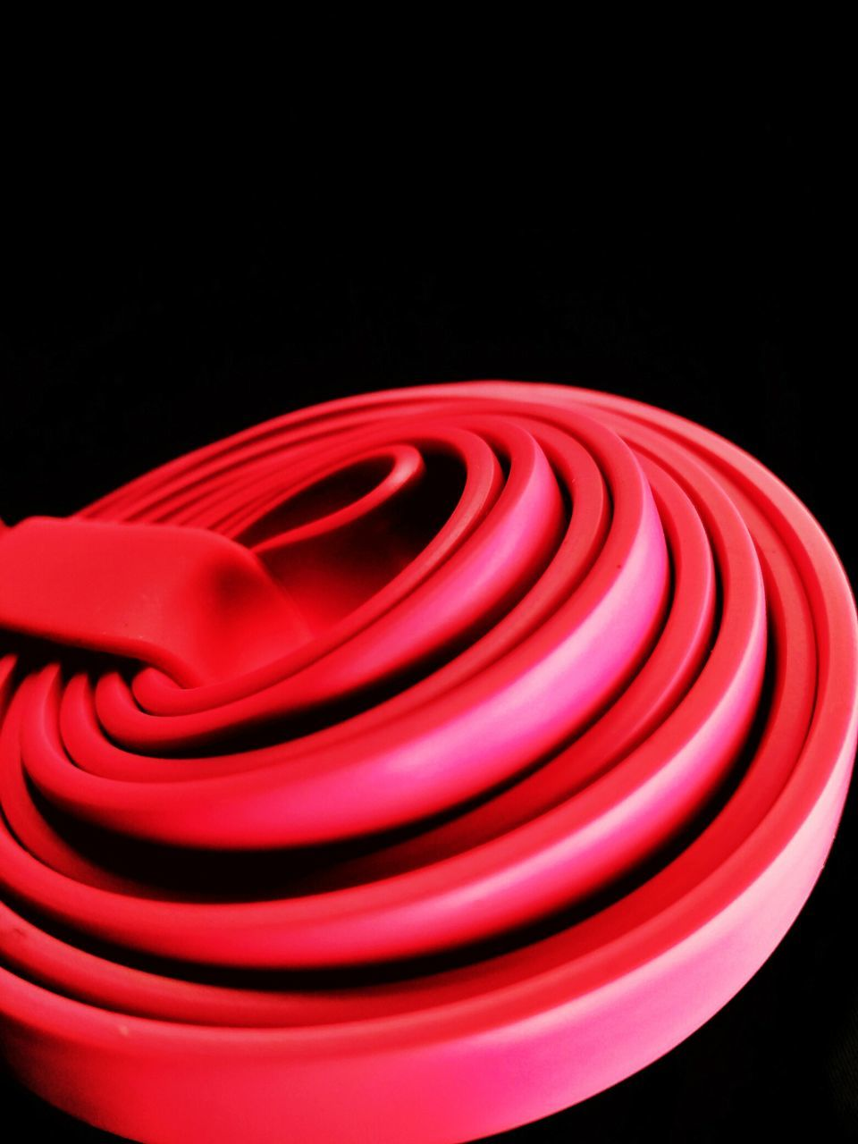 red, black background, studio shot, spiral, no people, close-up, pattern, indoors, night
