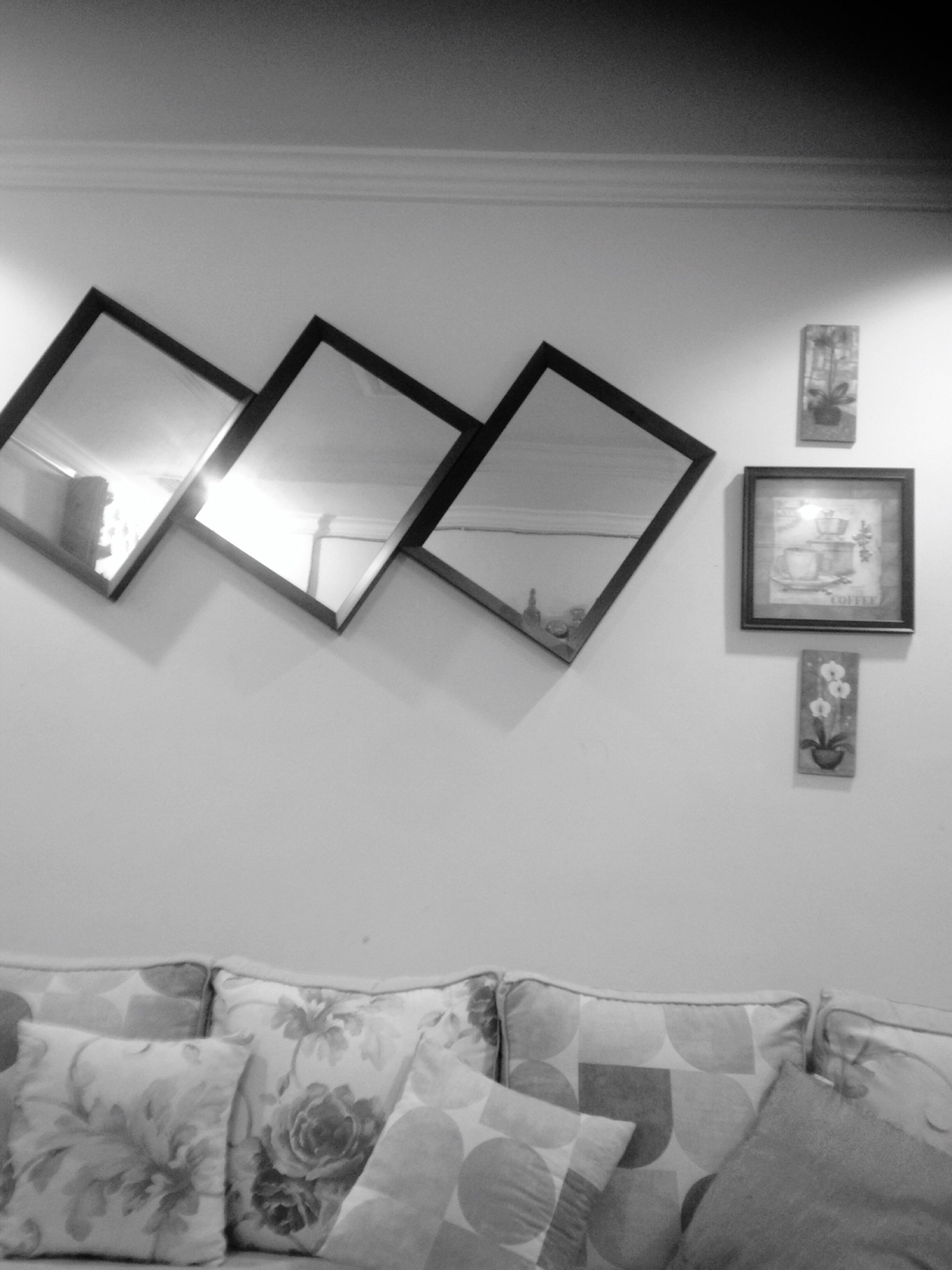 indoors, wall - building feature, wall, communication, absence, architecture, built structure, home interior, text, no people, chair, empty, technology, white color, in a row, picture frame, tile, house, sofa, day