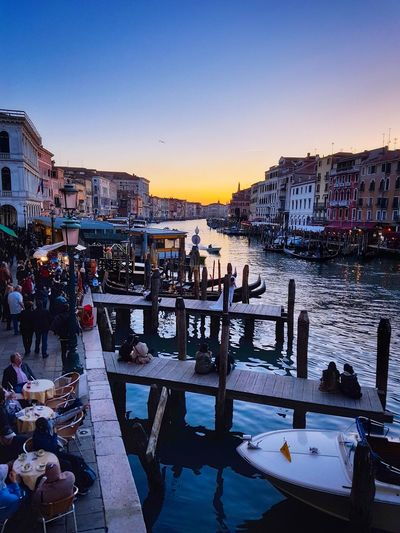 Sunset Show Venezia Veneto Italy Ponte Di Rialto Rialto Bridge Canal Grande Grand Canal Enjoying Life Bars And Restaurants Have A Seat And Relax Water Reflections Tranquility Clear Sky Scenic Landscapes Moored Boats Gondolas Piers Travel Destinations Most Desired Paint The Town Yellow