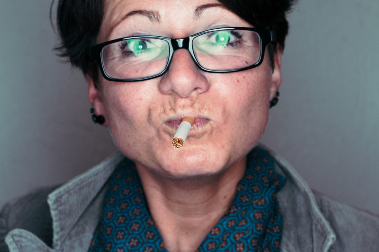 Let's quit smoking Portrait Eyeglasses  Headshot Looking At Camera Adults Only Women One Person Young Women Quit Smoking Cigarette  Ringflash Girl POTD Photooftheday Picoftheday Resist TCPM