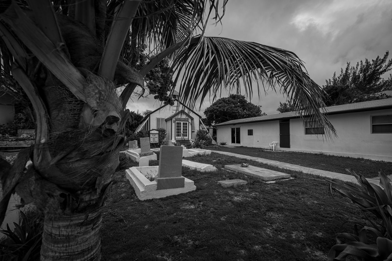 Wesley Methodist Church Architecture Bimini Blackandwhite Photography Building Exterior Built Structure Cemetery Church Cloudy Day Growth Islandlife Nature No People Old Buildings Old Town Outdoors Palm Tree Photographyisthemuse Sky Small Town The Bahamas Tombstones