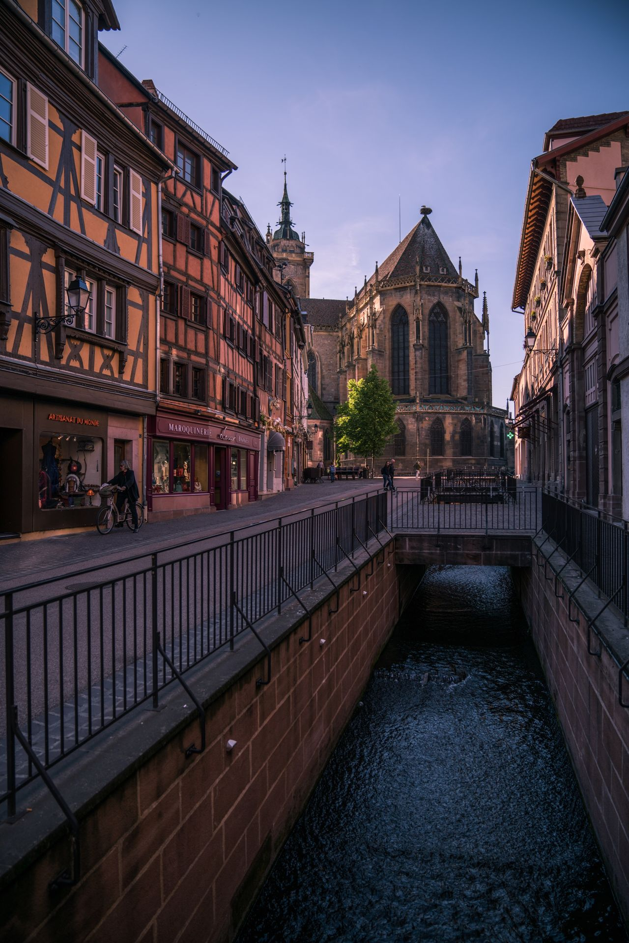 Colmar. Architecture_collection Dusk Travel Destinations Travel Traveling Travel Photography Alsace Vive La France France Colmar Colmar, Alsace, France Colors Colorful Church Architecture Multi Colored Canal Architecture Built Structure Religion Place Of Worship Cityscape Canals Building Exterior Outdoors