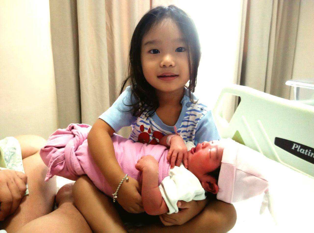 In my sister's arm One Girl Only Children Only Child Looking At Camera Portrait Girls Sitting Childhood Baby newborn
