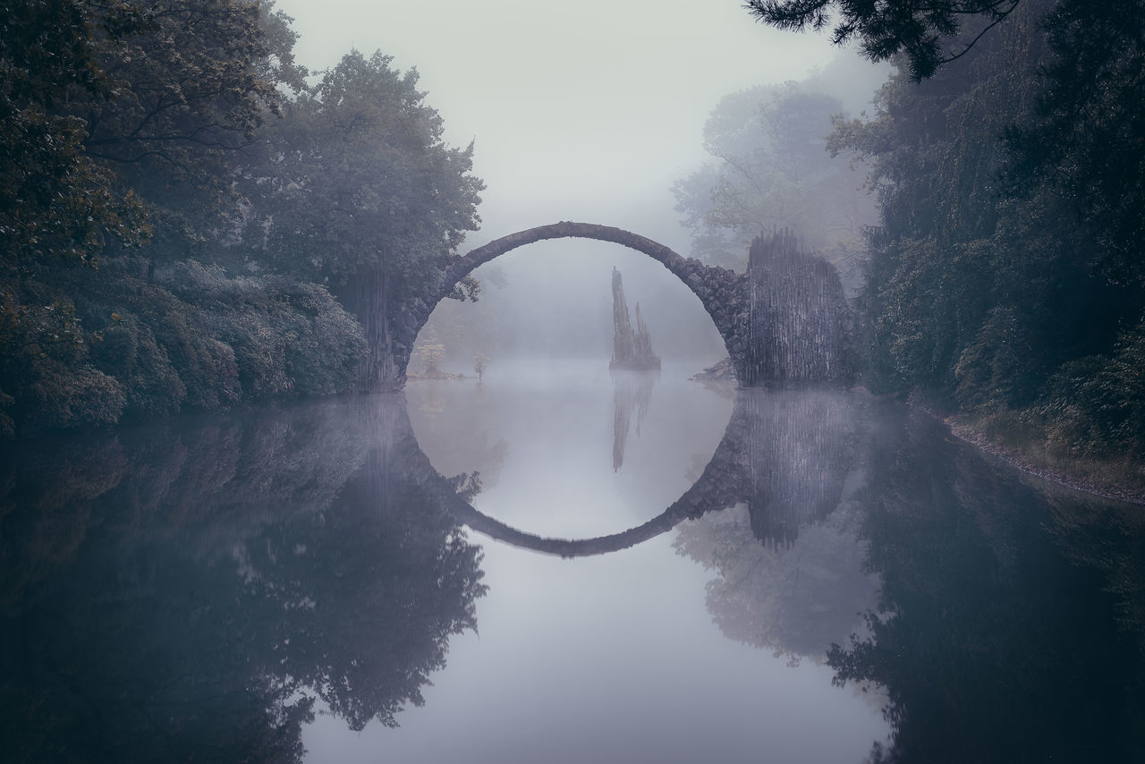 Gates to Avalon Arch Arch Bridge Architecture Atmosphere Atmospheric Mood Beauty In Nature Bridge - Man Made Structure Built Structure Calm Day Devilsbridge Distant Nature Non-urban Scene Park Rakotzbridge Reflection Scenics Sky Standing Water Tranquil Scene Tranquility Tree Water Water Surface