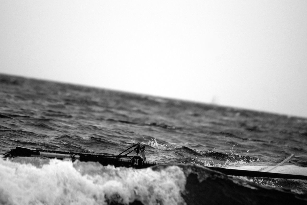 """9/13 ..watching you rebel   """"give it up"""".. Black And White Blackandwhite Clear Sky Confidence  Damaged Focus On Foreground Horizon Over Water Leisure Activity Men Monochrome Motion Sea Seaside Visual Thoughts Water Waves"""