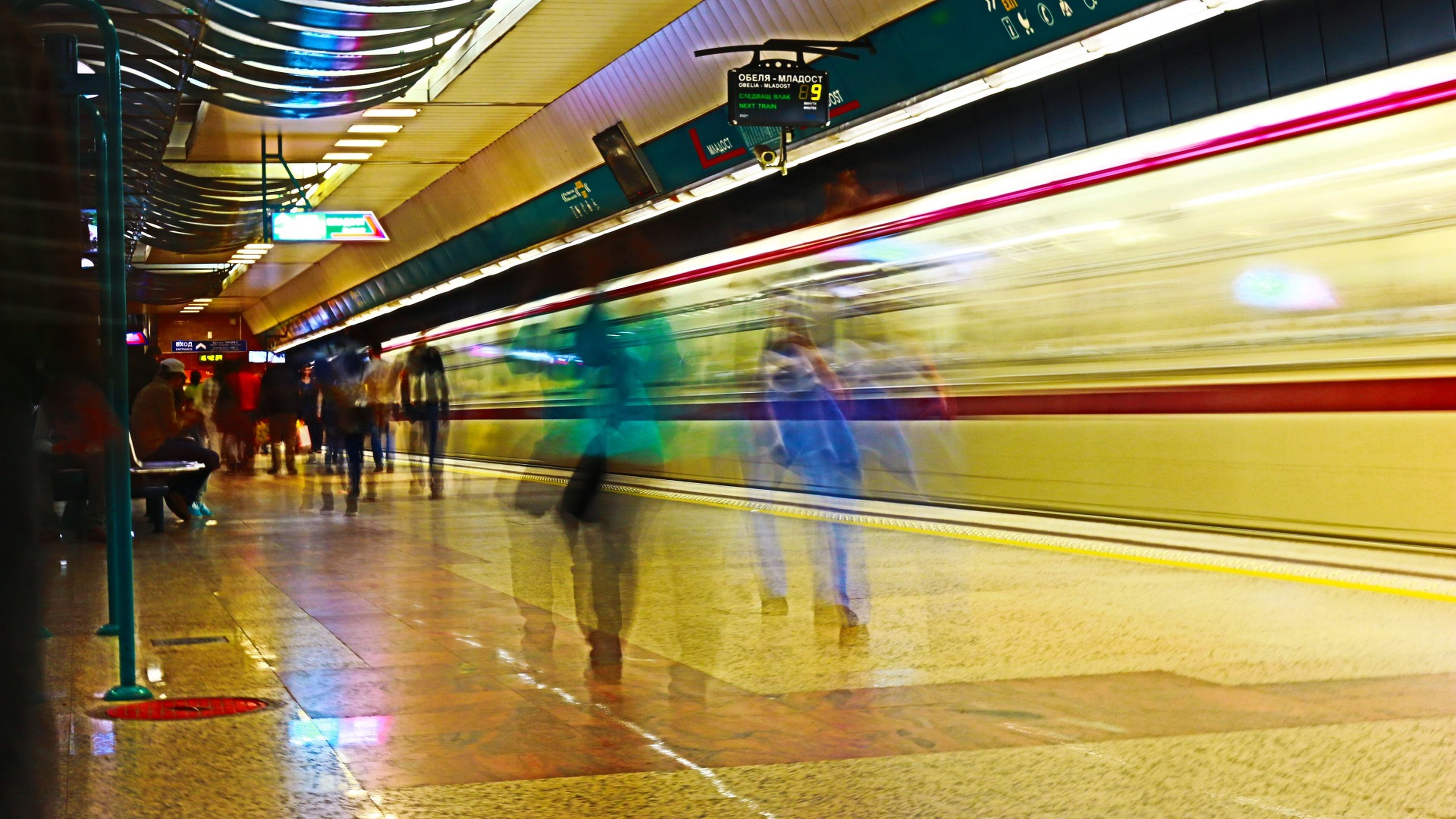 illuminated, blurred motion, night, indoors, lifestyles, motion, men, speed, person, long exposure, leisure activity, built structure, travel, city life, large group of people, transportation, reflection, walking, subway station