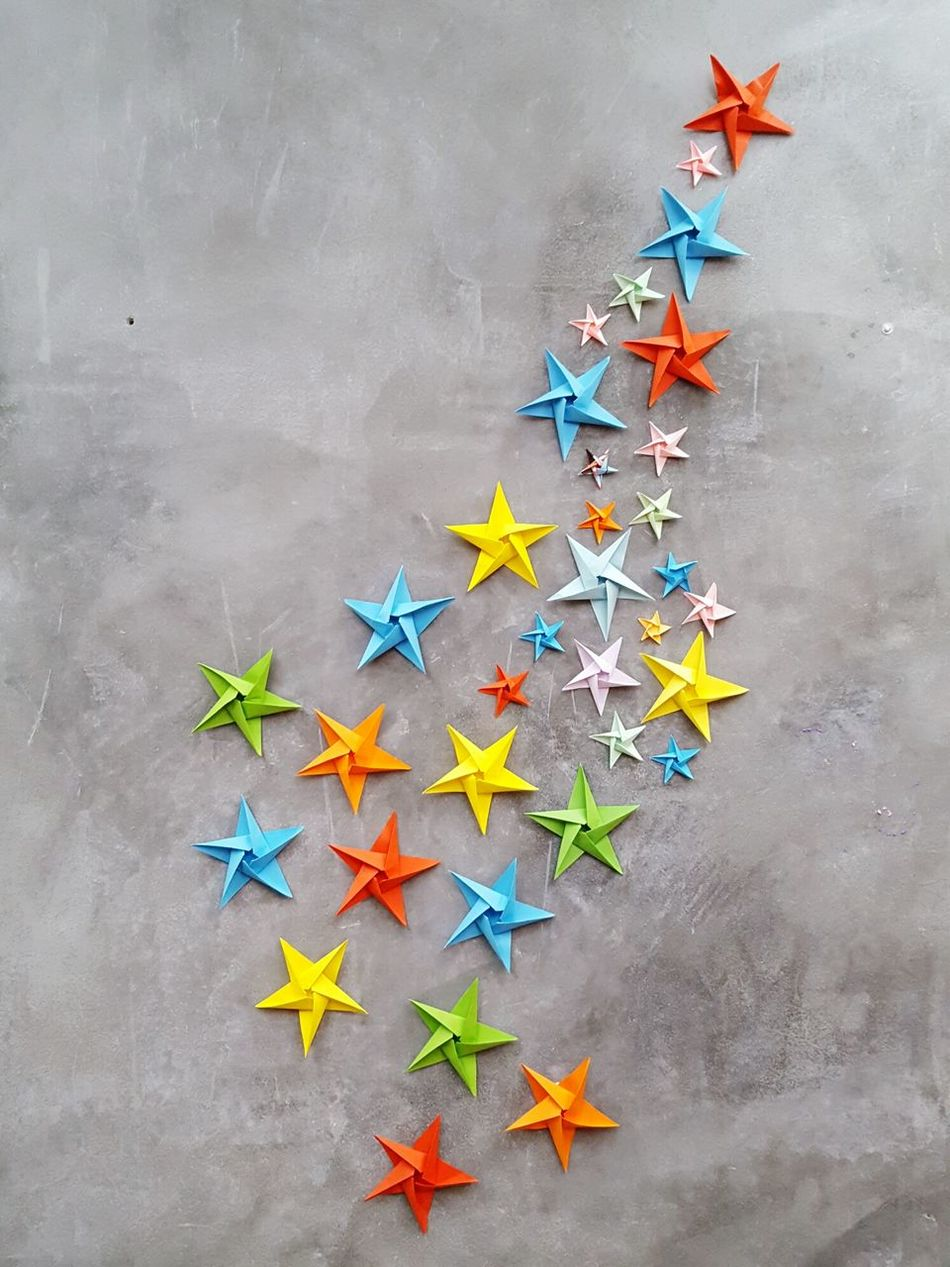 To the stars Celebration Multi Colored Christmas Decoration Christmas Shape No People Stars Colors Cement Origami Red Green Blue Yellow Paper Papercraft Paper Art