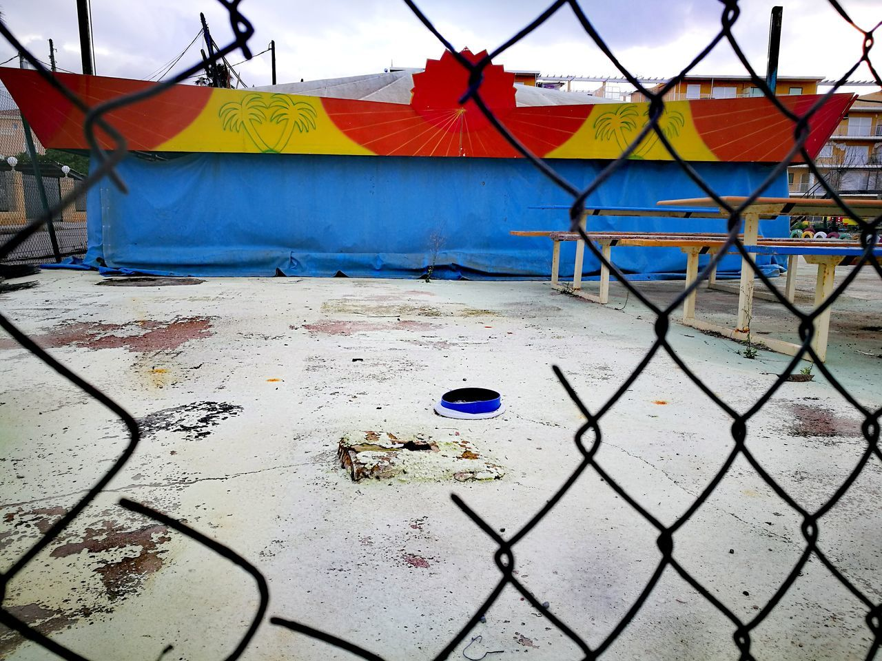 Built Structure Building Exterior Multi Colored Architecture No People Outdoors City Sky Day Traveling Home For The Holidays Hat On Pavement Cityscape Outdoor Abandoned Places Abandoned & Derelict Finding New Frontiers Street Photography City Chainlink Fence