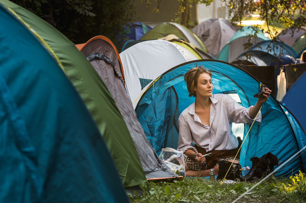 tent, camping, real people, young women, women, day, outdoors, shelter, young adult, tree, nature, adult, people