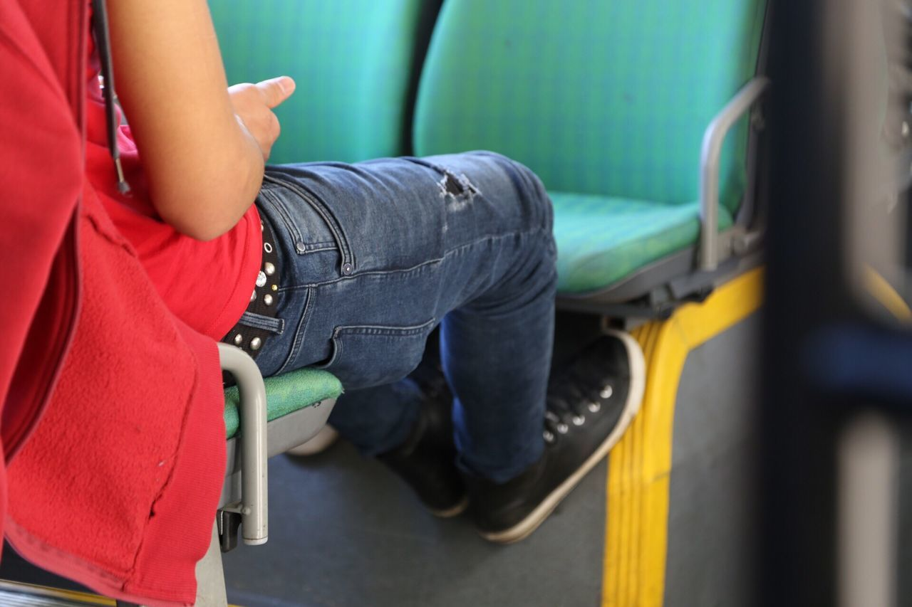 sitting, one person, casual clothing, real people, childhood, boys, low section, indoors, vehicle seat, physical impairment, patient, day, people