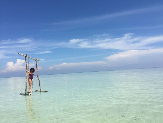 Karimunjawa island 2 Beauty In Nature Blue Clear Water Cloud - Sky Day Full Length Horizon Over Water Leisure Activity Nature One Person Outdoors Real People Scenics Sea Sky Swing Tranquil Scene Tranquility Vacations Water Water Swing Waterfront Weekend Activities Woman