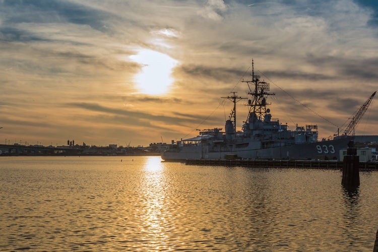 Washington, DC, USA - March 29 2015: The sun sets over the Display Ship Barry moored in the Anacostia River at the Washington Navy Yard in Washington, DC Boat DC, Display Ship Barry DS Barry Harbor Mode Of Transport Nautical Vessel Navy Sun Sunset United States Navy USS Barry Water