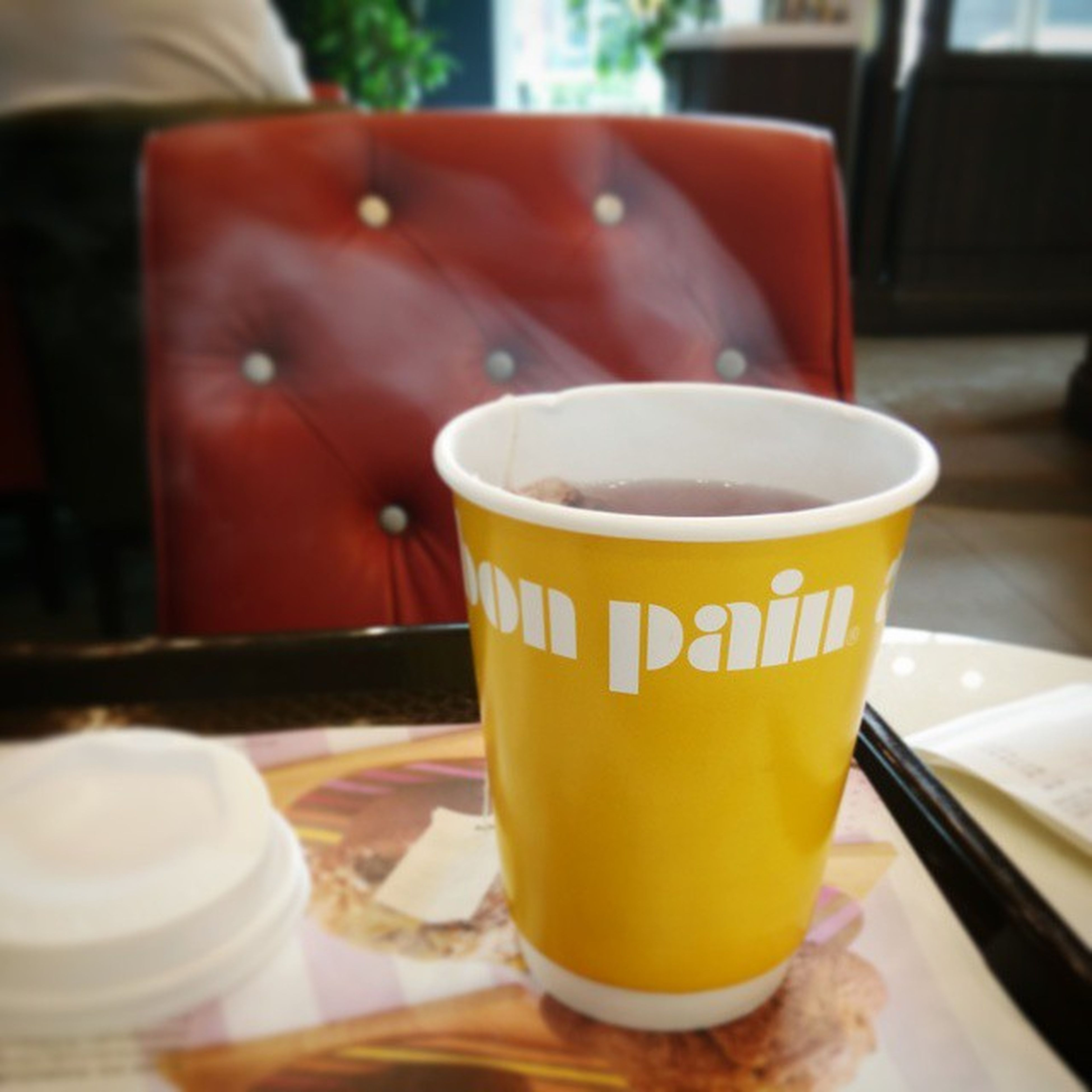 drink, food and drink, refreshment, coffee cup, freshness, coffee - drink, table, indoors, saucer, frothy drink, coffee, close-up, still life, cup, healthy eating, beverage, cafe, cappuccino, drinking glass, focus on foreground