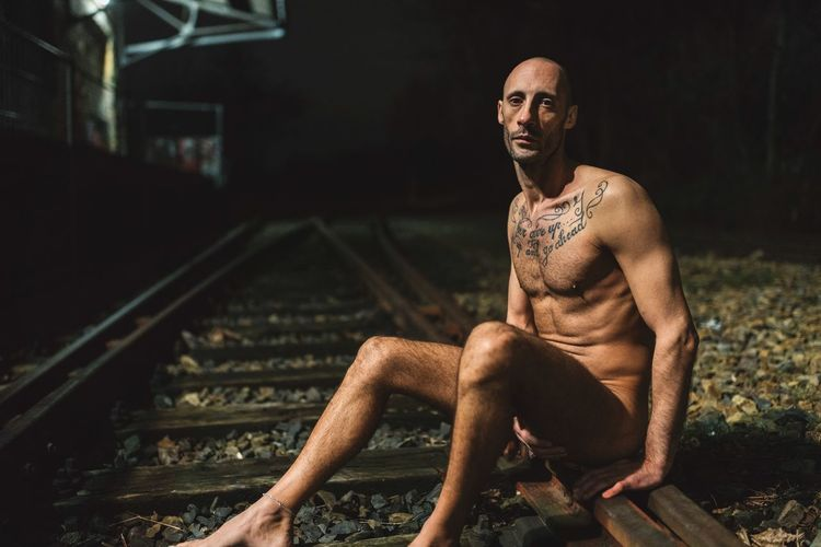 Train Tracks 🛤 Eye Contact Sony A7RII Full Frame Art is Everywhere Healthy Lifestyle Body & Fitness Body Curves  Nude_not_porn Nude_model Light And Shadow Night Photography Train Tracks Young Man Italian Model Bald Man Bald Head Male Model Model Muscular Build Shirtless Sitting Lifestyles Strength Real People Exercising One Person Night Portrait Outdoors People